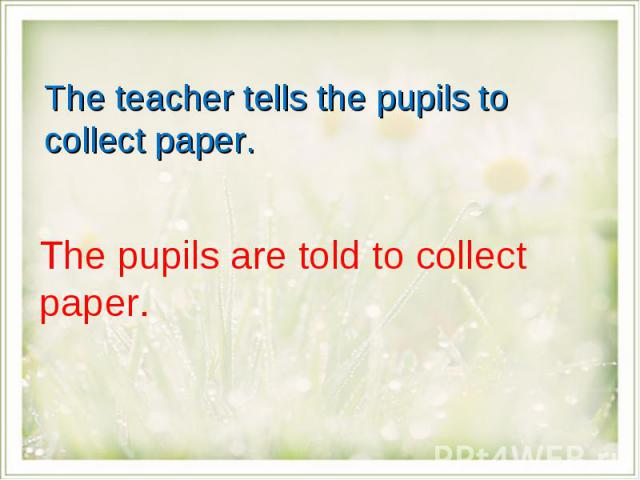 The teacher tells the pupils to collect paper.The pupils are told to collect paper.