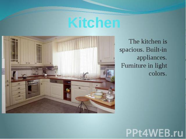 Kitchen The kitchen is spacious. Built-in appliances. Furniture in light colors.
