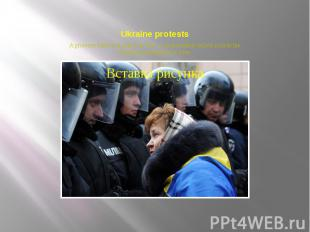 Ukraine protests A protester faces riot police on Dec. 3, as thousands rallied o