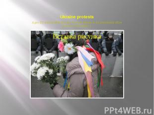 Ukraine protests A pro-EU activist offers flowers to police officers at the pres