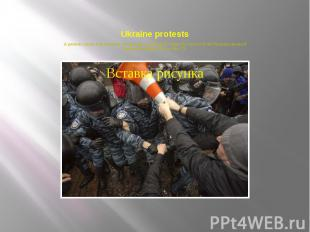 Ukraine protests A protester clashes with riot police during a rally supporting
