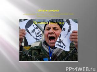 Ukraine protests A demonstrator holds a torn portrait of Ukrainian President Vik