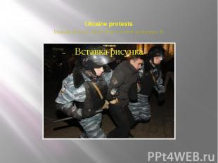 Ukraine protests Ukrainian riot police officers detain a protester on November 3