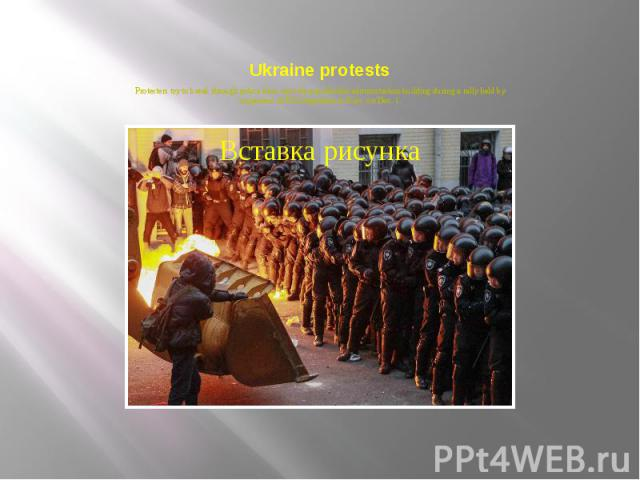 Ukraine protests Protesters try to break through police lines near the presidential administration building during a rally held by supporters of EU integration in Kiev, on Dec. 1.