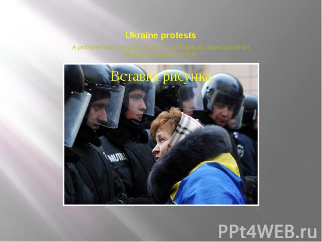 Ukraine protests A protester faces riot police on Dec. 3, as thousands rallied outside the Ukrainian parliament in Kiev.