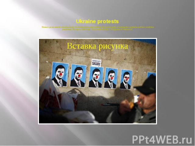 """Ukraine protests Ukraine's prime minister warned protesters blockading government buildings that anybody guilty of violating the constitution and laws would face punishment. The sign in white reads: """"Requirement Number 1: Resignation of Yanukov…"""