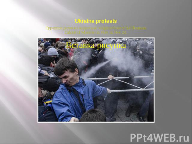 Ukraine protests Opposition protesters and riot police fight in front of the Ukrainian Cabinet of Ministers in Kiev, on Nov. 24.