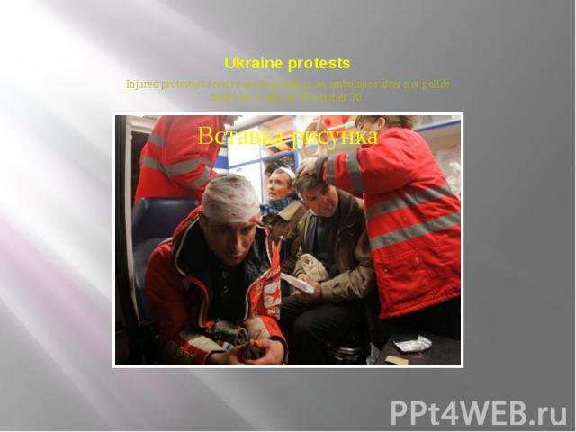 Ukraine protests Injured protesters receive medical help in an ambulance after riot police broke up a rally on November 30.