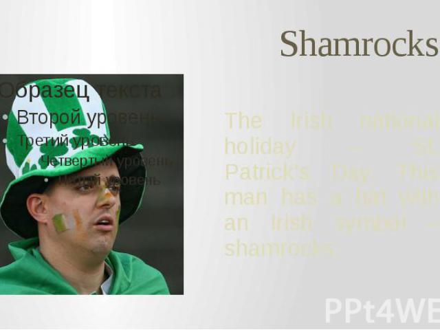 Shamrocks The Irish national holiday – St. Patrick's Day. This man has a hat with an Irish symbol – shamrocks.