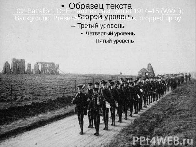 10th Battalion, CEF marches past, winter 1914–15 (WW I); Background: Preservation work on stones, propped up by timbers.